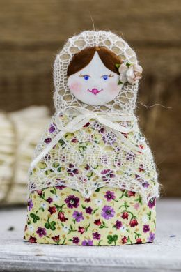 Russian matryoshka in Orenburg shawl